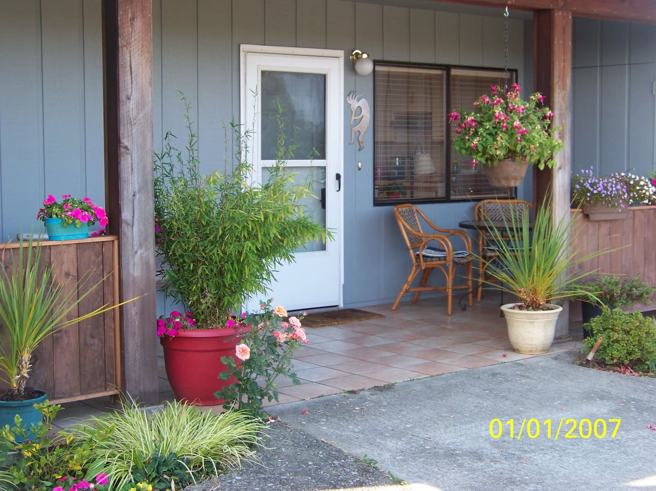 Private entrance, covered patio.