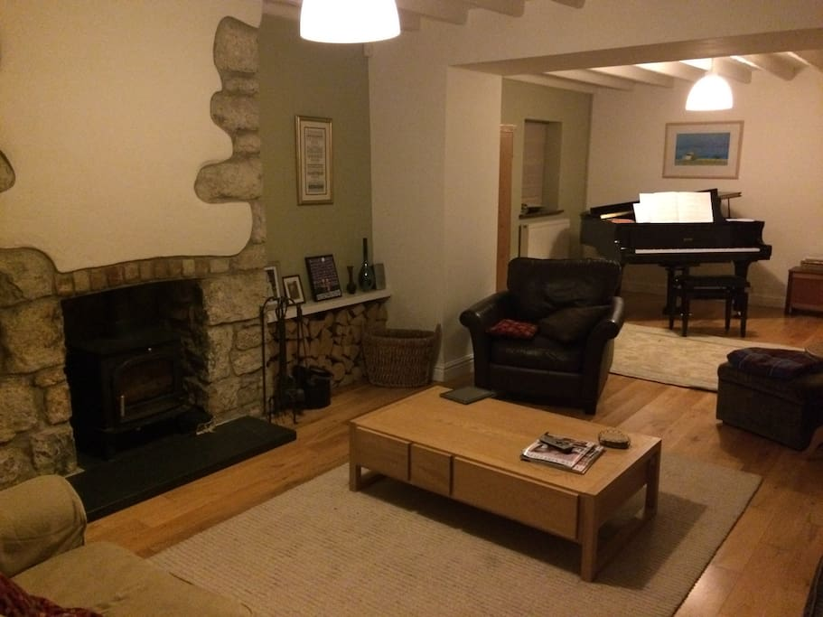 lounge with log burner and piano