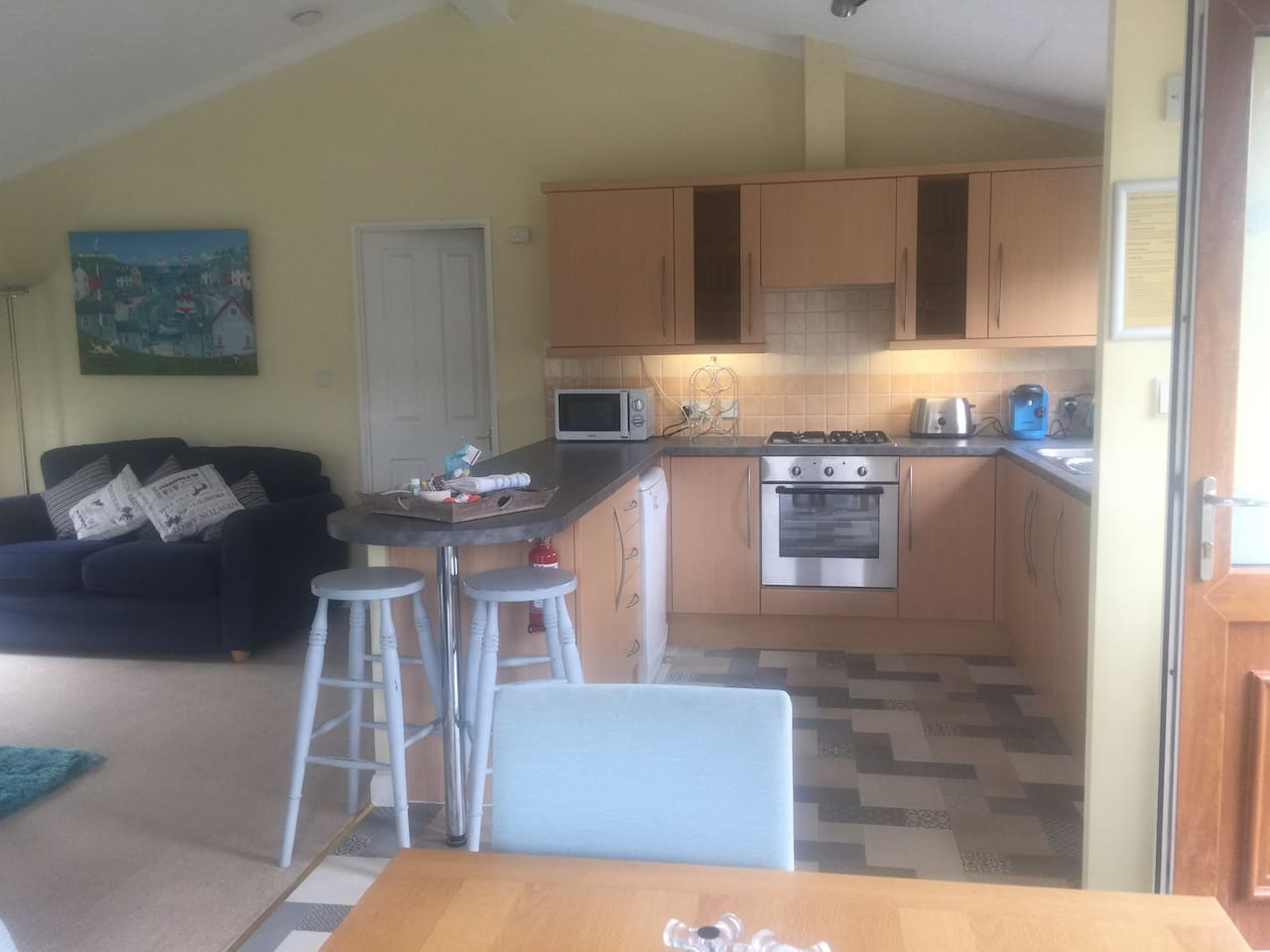 our lovely lounge, kitchen, diner with double doors out to the decking and beautiful views.  The kitchen has a dishwasher, oven, microwave, tassimo coffee machine, fridge freezer