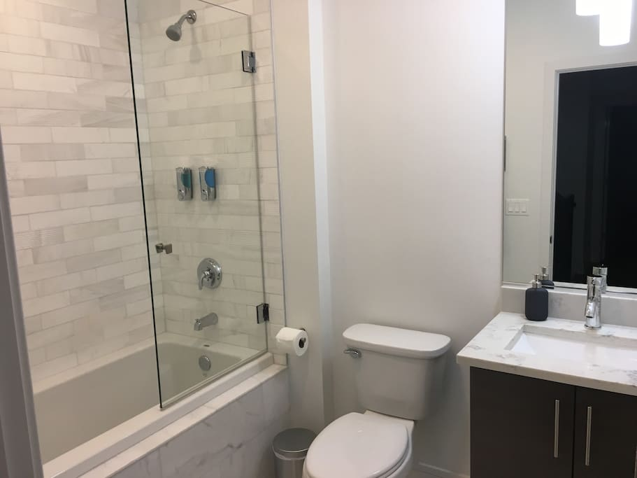 Bathroom down the hall with bathtub.  Shared with only one other room.