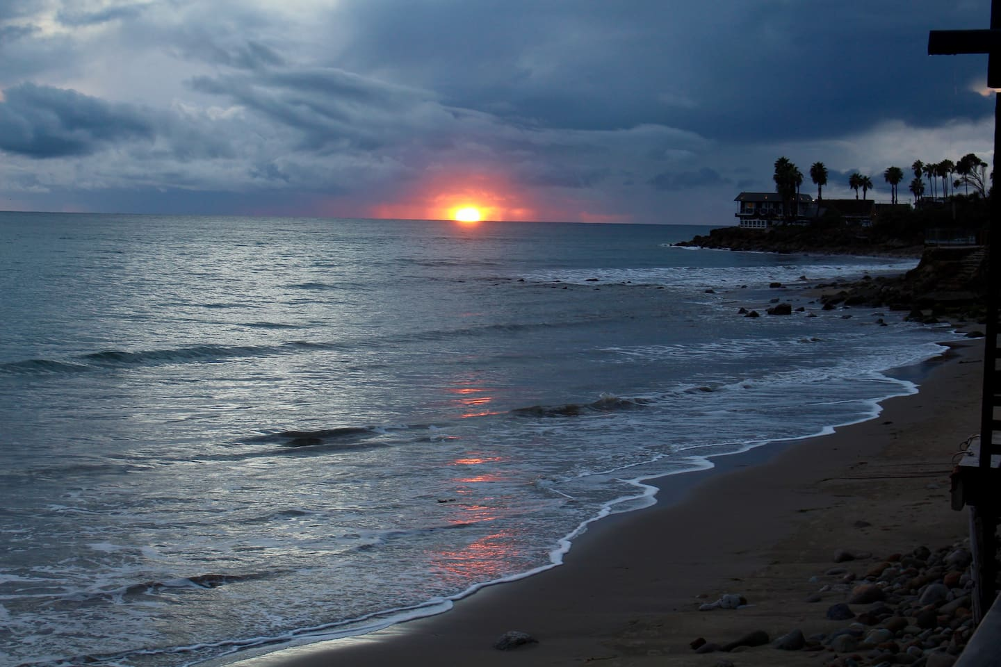 A beautiful sunset over paradise, Malibu beach.  Calm seas, the beach all to yourself, magic in the air with the serenity of the sea.