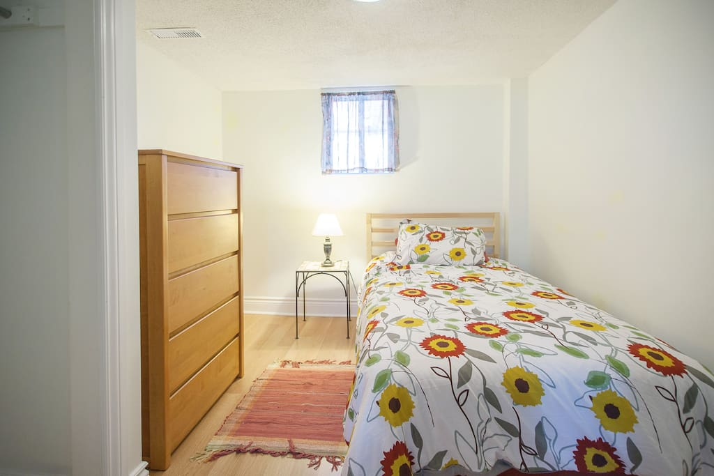 Single-sized bedroom with adjoining den/living space