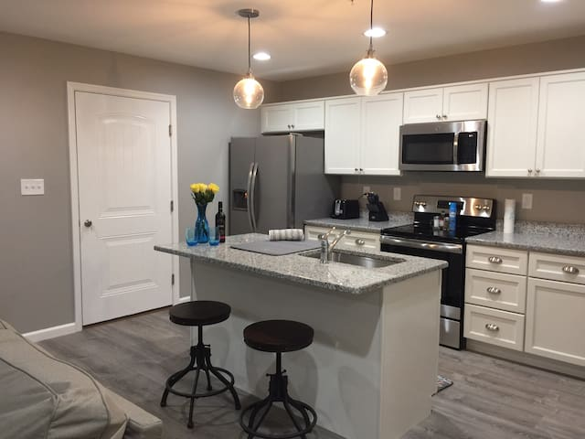 Brand new kitchen with small island for extra seating