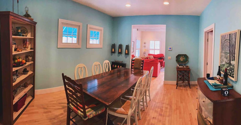 Large dining room with seating for 8.