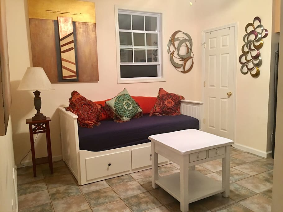 downstairs living area day bed converts to a king size bed