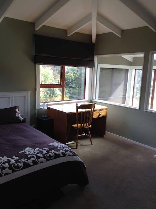 Larger second floor bedroom, desk and bush views