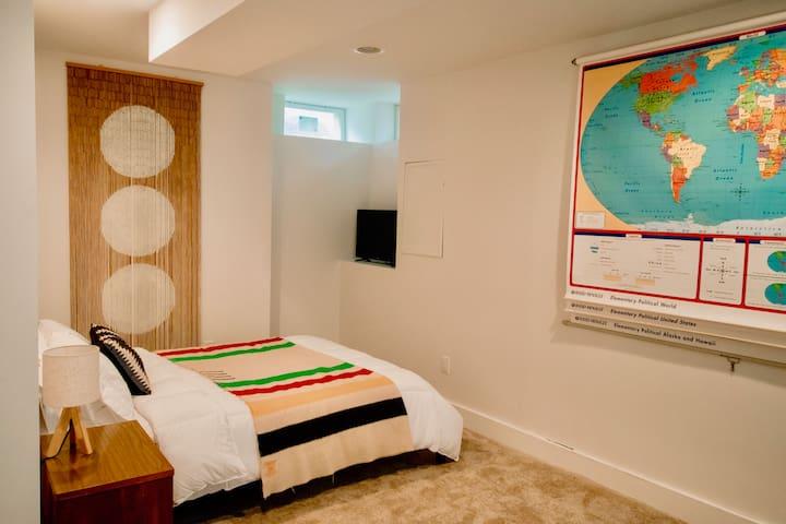 Sixties inspired basement sleeping area with full bathroom.