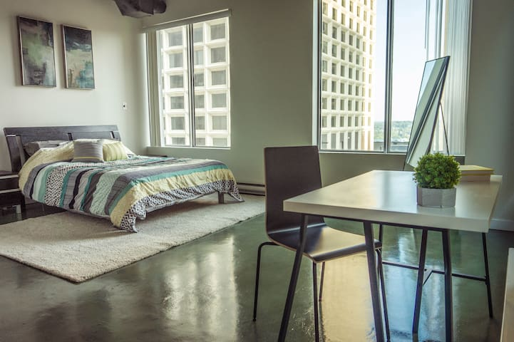 Downtown Central Corner Loft | Indoor Train Access