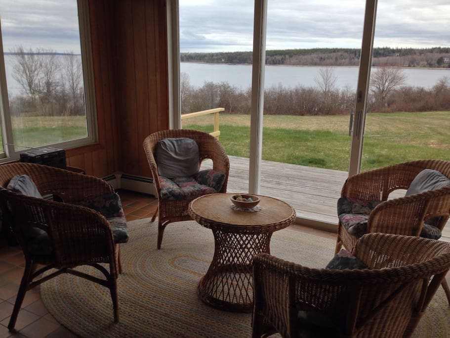 The sun porch is a closed-in glass room that has a nice view of the water, sunrises and sunsets.  Beyond this room there is also a deck with seating outside.
