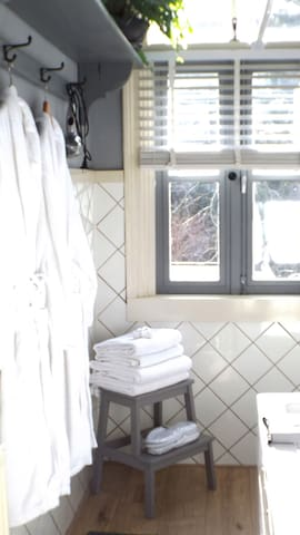 Sunny bathroom New: fresh slippers and dressing robes