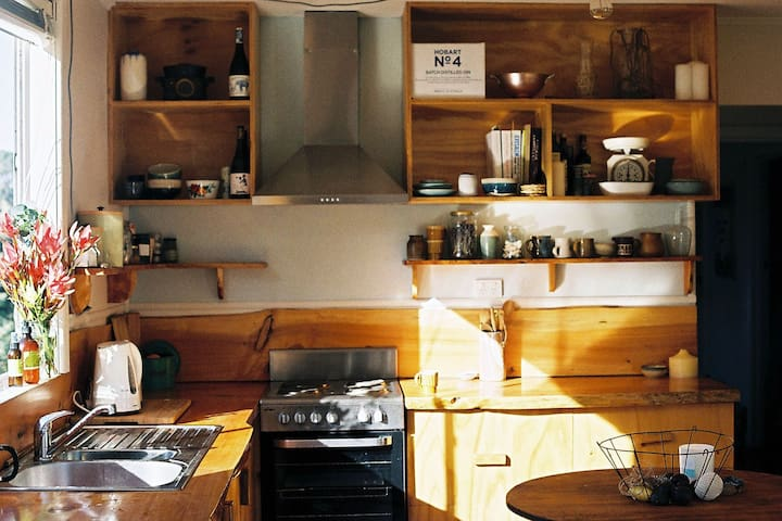 The sun-filled kitchen, full of carefully curated findings