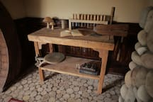 Woodworking bench with antique wood vise & swing arm stool