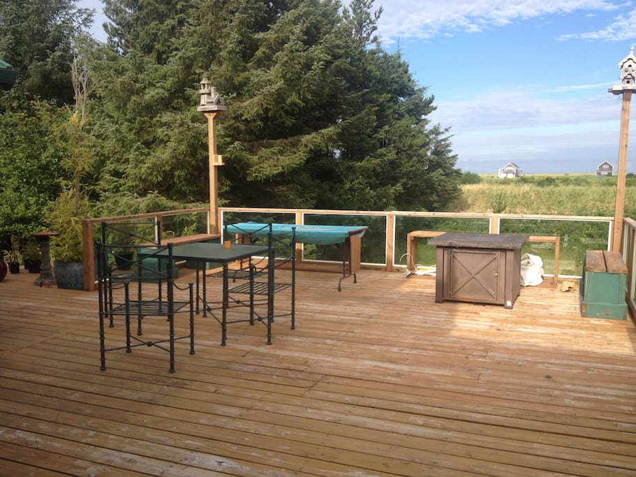 large outdoor space with propane fire pit and trail to the beach