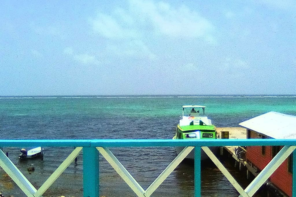 "Gorgeous view of the Mesoamerican Barrier Reef from the veranda, Sit comfortably outside basking in the beauty that the island of Ambergris Caye has to offer. Conveniently located directly in-front of the most frequently used water taxi ""San Pedro Belize Express Ltd"" (Boat in the picture above) a few steps away from the dock station of the water taxi and up a flight of stairs and you are in you room ready to relaxing and enjoy the ambient sea breeze."