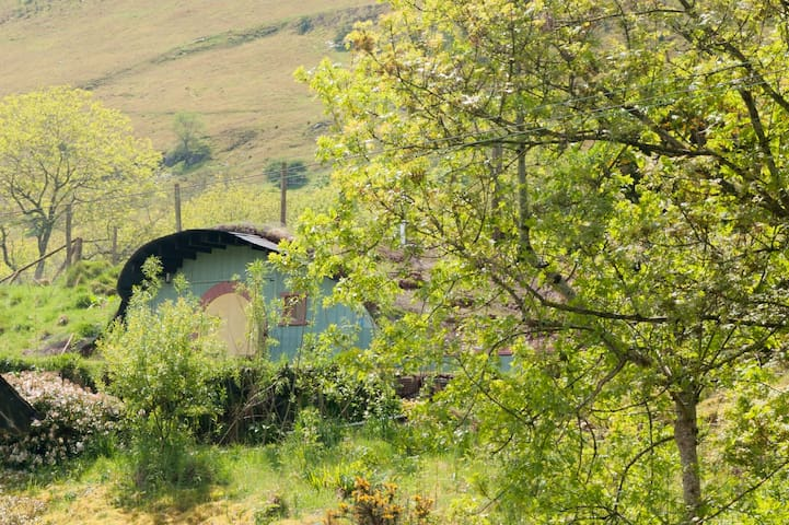 Th Hobbit House is nestled in the Black Mountains in the Brecon Beacons National Park