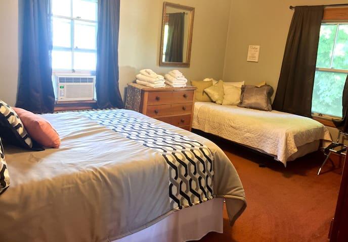 Bedroom 1: Queen Bedroom with a twin bed.