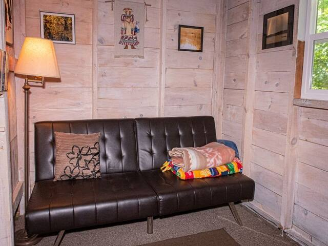 In the den, the couch folds out to to a futon-style bed.