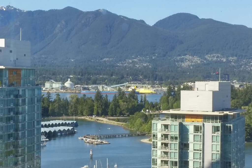 Breathtaking View of Coal Harbour, Stanley Park and North shore mountains.