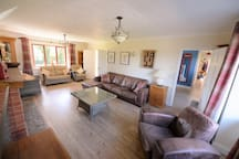 Large 24' Lounge with windows at either end. Double doors lead through to large Dining Room.