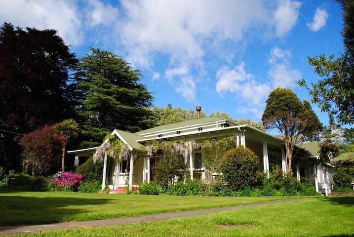 Large farmhouse  in  unique landscape.