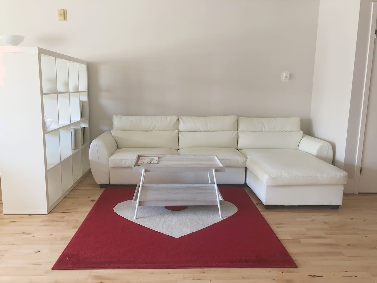 Living room area White leather sectional sofa and coffee table