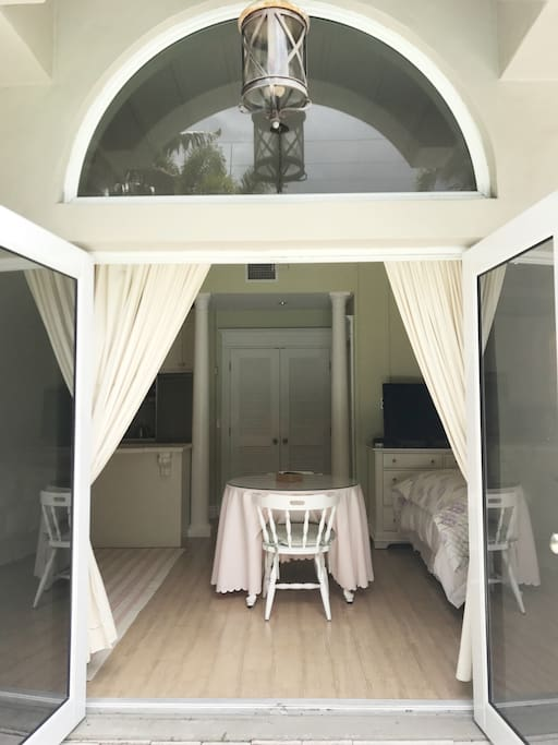 Double French doors open up to the back patio.