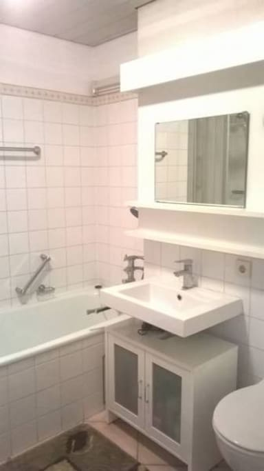Bathroom has a walk-in shower and  bath tube. Towels, soap, shampoo and more included.