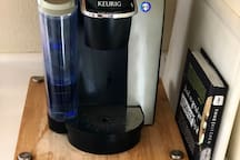 The primary coffee maker is a Keurig with provided K-Cups stored beneath. I buy fully compostable, California roasted coffee pods for your enjoyment.