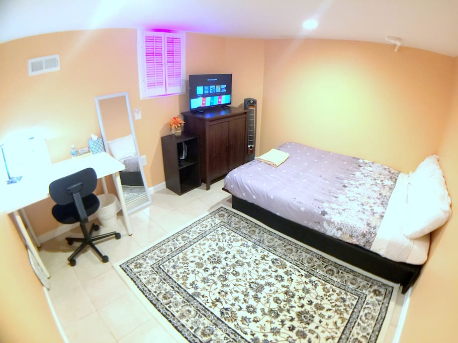 Your very comfortable bedroom space with bed full size bed. Mood light faux window can be turned on or off.