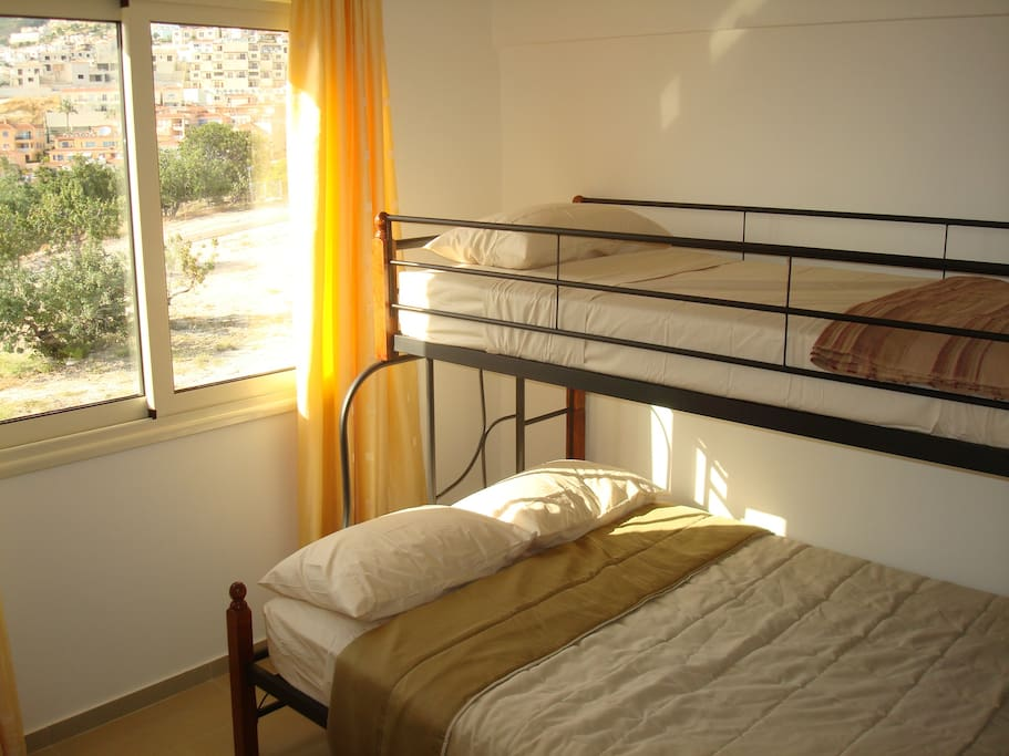 2nd bedroom with double and single bed (bunk style).