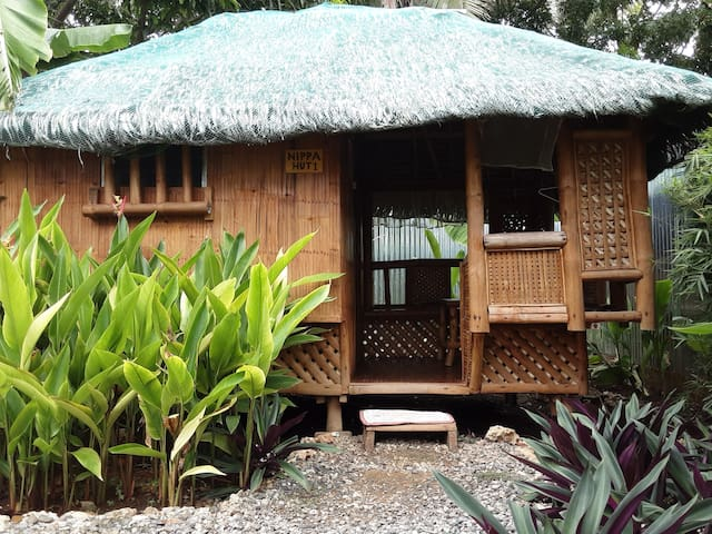 ADRIANAS PLACE double bed nippa hut
