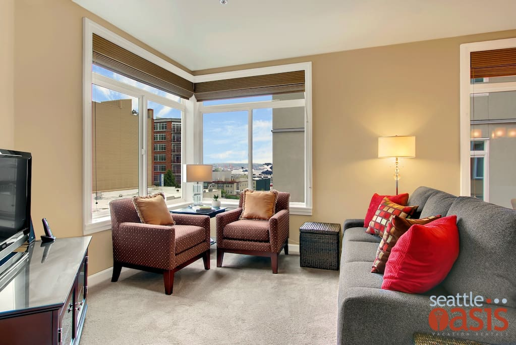 Lots of light comes into this corner unit with a peekaboo view of Elliott Bay