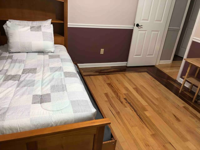 2nd guest bedroom with twin bed and trundle on main floor