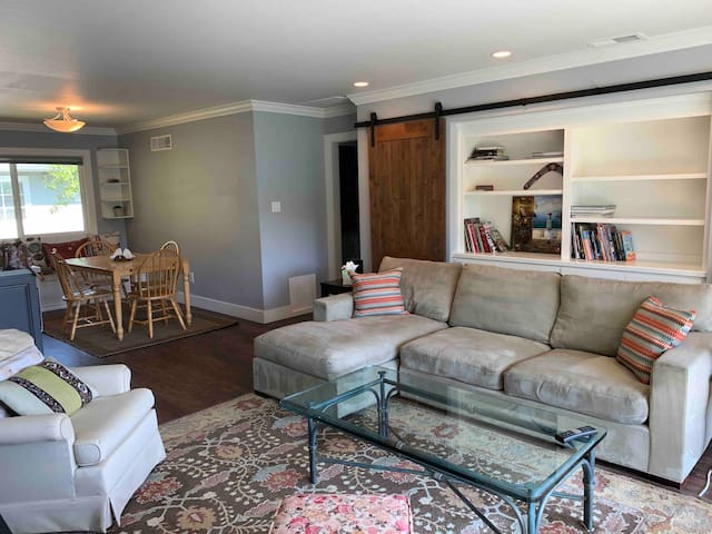 Huge Crate and Barrel sofa comfortably seats 3-4 people. There are 2 additional chairs in the tv/living area. Open concept allows for socializing with those at the dining table and in the kitchen.