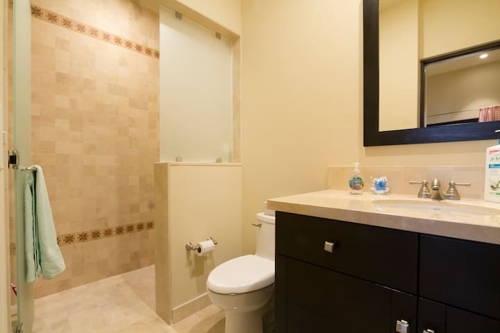 Bathroom attached to 2-Twin bedroom with shower & sink