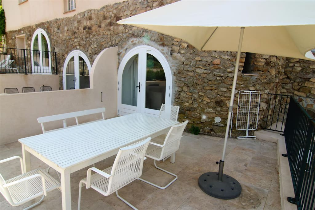 Terrace with furniture and parasol