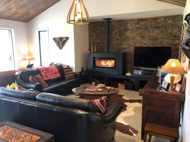 Cozy lounge with large fire place & 52inch TV