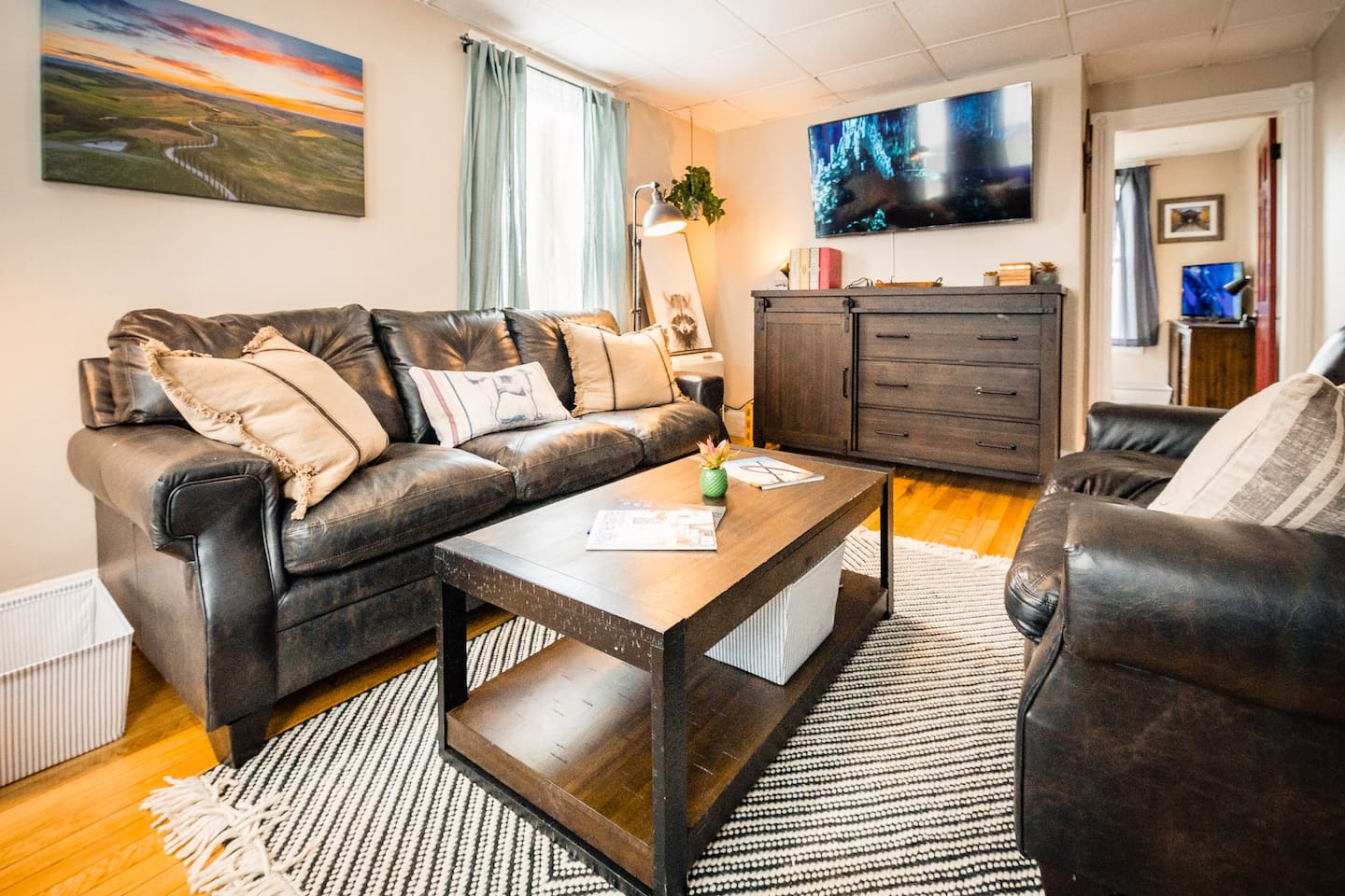 """Living room with a 55"""" smart TV and Netflix ready to go!"""
