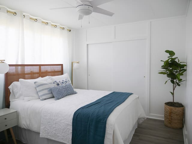 Light and airy bedroom with queen size bed