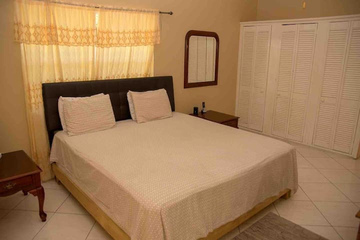 Master bedroom. Private, located on the second floor. King sized bed, large closets, en-suite bath.