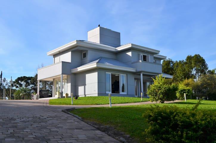 Recanto energizante - casa de luxo com lareira