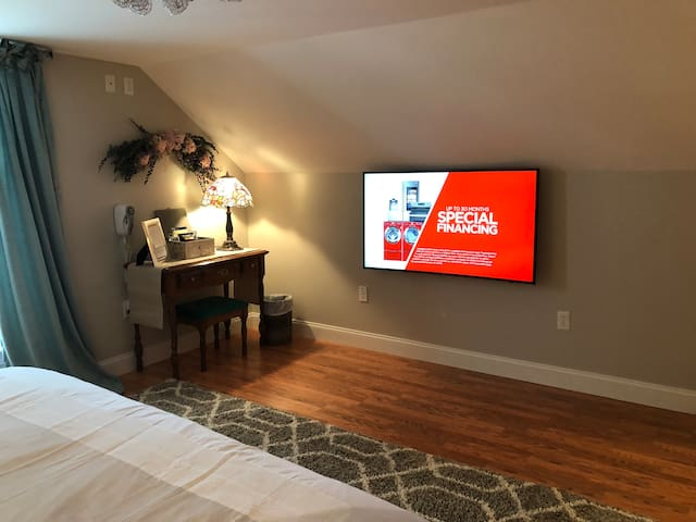 """55"""" curved flat screen television that features streaming and Dish TV."""