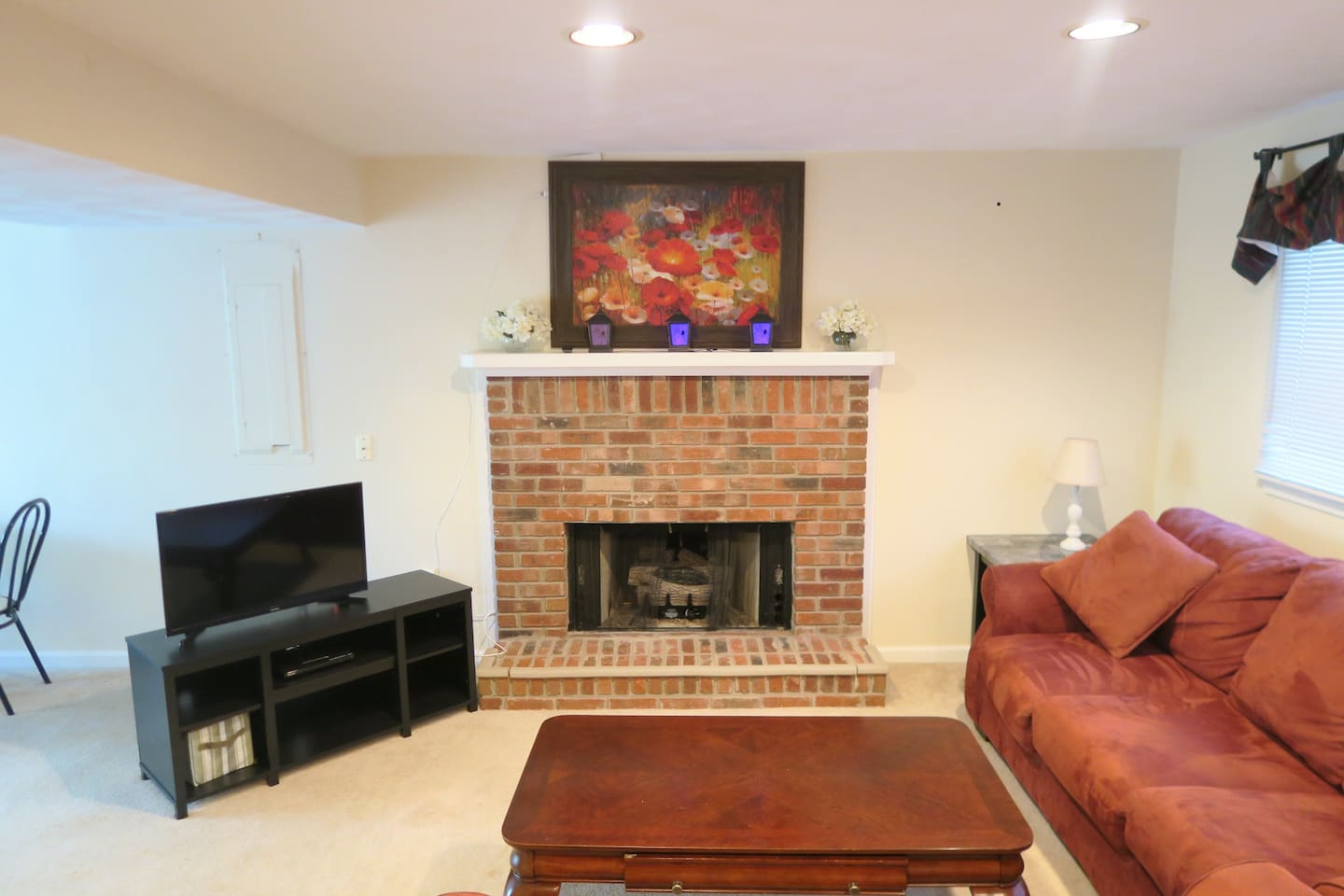 Family room with gas fireplace, comfortable seating and TV.  We have an antenna and Netflix available for guests, plus free wifi access.