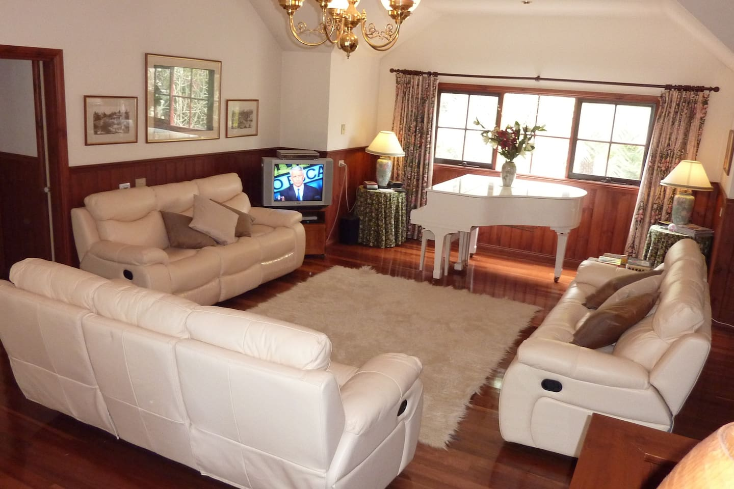 This is your own lounge room. The host lounge room is downstairs. It comfortably seats a maximum of 8 guests.
