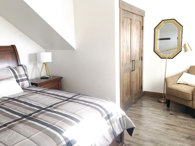 The sitting area in the bedroom is a cozy place to snuggle up and read a book with natural light in the afternoon or early evening!