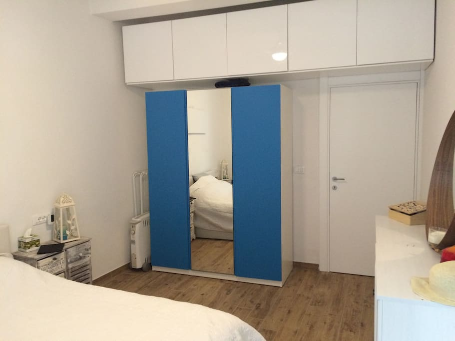 Wardrobe with big mirror.