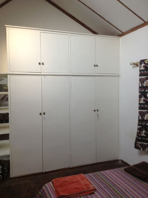 Lots of storage space in the large built in cupboards in room 1