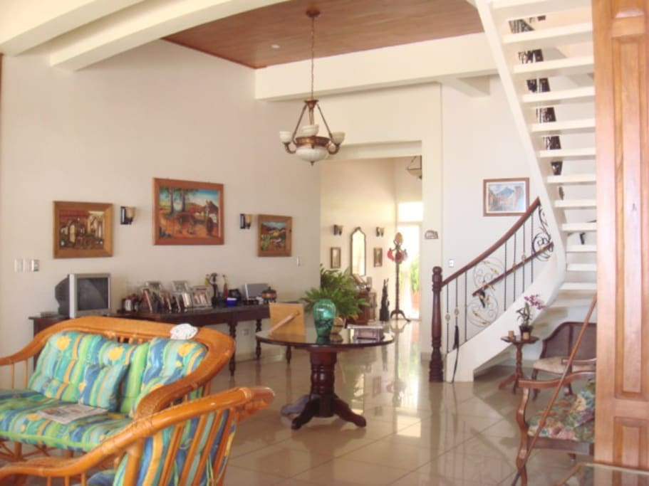 In these images you can see the entrance to the house the double front door is constructed of PVC, ideal for properties located at oceanfront, the PVC material is totally resistant to salinity and does not deteriorate over time, the entire property has these types of doors and windows.  view of the stairs to the second floor where the master bedroom, bathroom, Jacuzzi, office, balcony in front of the sea and balcony in front of the entrance to the property, both equipped with supports for hammocks is where you can relax fully in privacy, peace and tranquility on the second level.