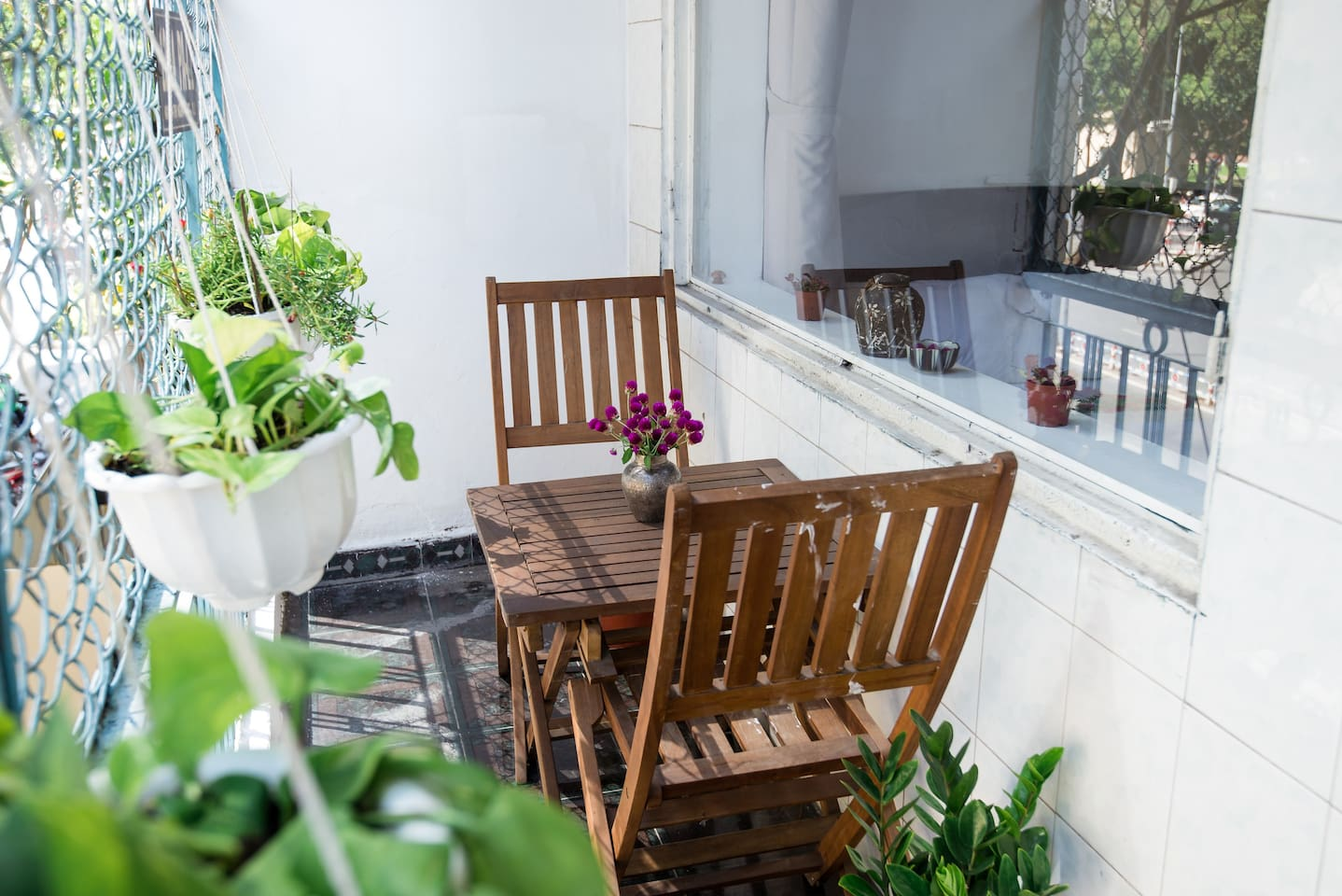 A beautiful sunny balcony with plant and flower.. Take a coffee cup and enjoy the sound of the city is so fantastic.