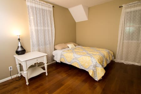 This is a private 2-bed (full, twin) bedroom with shared hallway bathroom in a beautiful Orange County home located within walking distance to restaurants and shopping, and a close drive to Disneyland and Knott's.